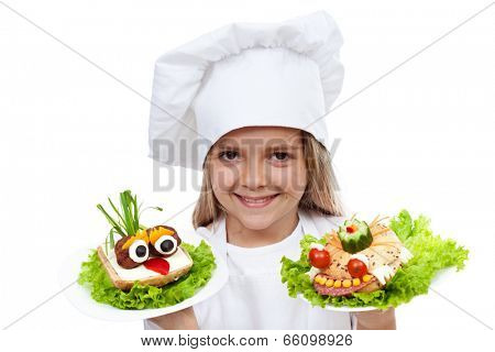 Happy smiling chef kid with creative food - creature sandwiches, isolated