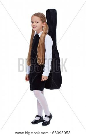 Little girl in elegant clothes carrying a guitar in a case - isolated