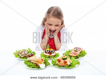 Little girl with creative party sandwiches - fresh food creatures, isolated