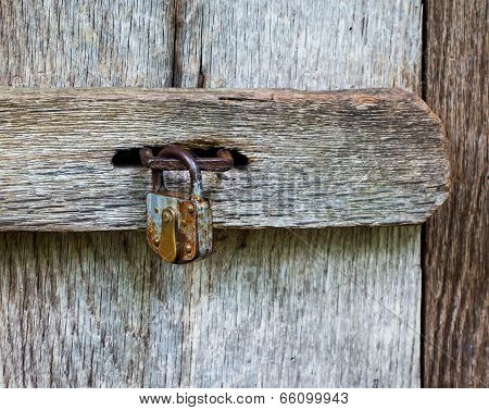 The Metal Lock On A Wooden Door