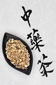 stock photo of licorice  - Licorice root with chinese herbal tea calligraphy script over rice paper - JPG