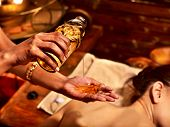 stock photo of panchakarma  - Young woman having oil massage spa treatment - JPG