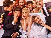 stock photo of banquet  - Bride and groom in photobooth - JPG