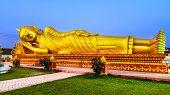foto of recliner  - Gold reclining Buddha - JPG