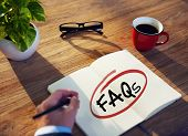 picture of faq  - Man with Note Pad and FAQs Concepts - JPG