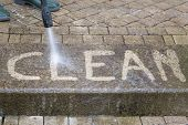 image of pressure-wash  - Outdoor floor cleaning with high pressure water jet - JPG