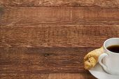 stock photo of cookie  - espresso coffee cup with a cookie on a rustic barn wood table  - JPG