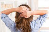 image of qigong  - Woman practicing self Reiki transfering energy through palms - JPG