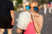 picture of candy cotton  - School girl eating cotton candy - JPG