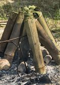 Постер, плакат: Old style camp fire cooking