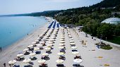 Beach With Tourists, Sunbeds And Umbrellas. Beach Of Kallithea, One Of The Most Visited Destinations poster