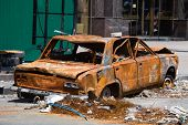 stock photo of extremist  - Burned car on Independence Square in Kiev - JPG