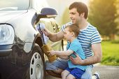foto of father time  - Young father with his little son washing car - JPG