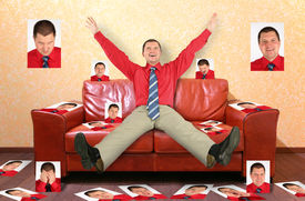 stock photo of megalomania  - man on the leather red sofa with the photographs collage - JPG