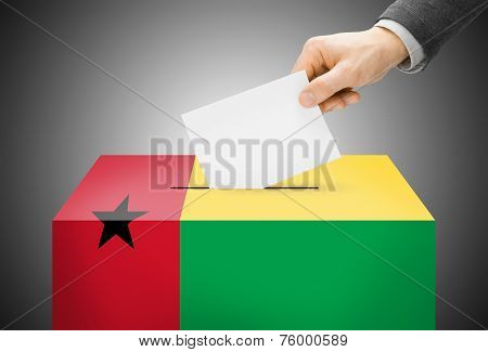 Voting Concept - Ballot Box Painted Into National Flag Colors - Guinea-bissau