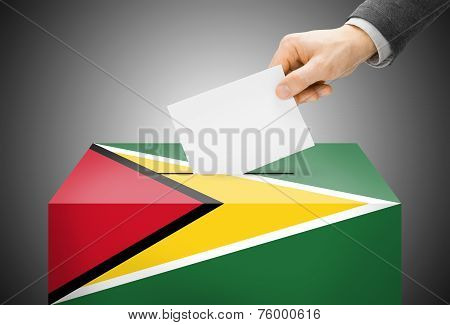 Voting Concept - Ballot Box Painted Into National Flag Colors - Guyana
