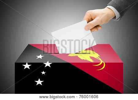 Voting Concept - Ballot Box Painted Into National Flag Colors - Papua New Guinea