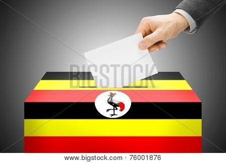 Voting Concept - Ballot Box Painted Into National Flag Colors - Uganda