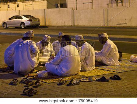Arabic Men Play Cards at night