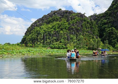 Visitors On Boats To Travel At Tam Coc
