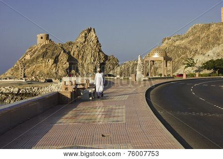 A Man walking on Muscat Promenade.