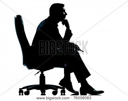 one  business man sitting in armchair silhouette Full length in studio isolated on white background