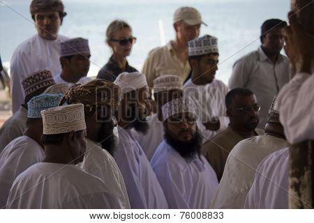 Men at the Daily Fish Market In Barka