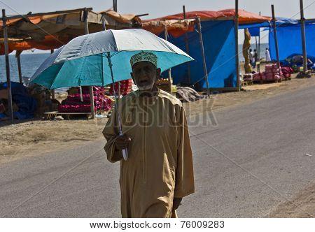 Arab Man with an umbrella