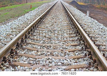 Railway railroad tracks in autumn day