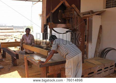 Men At Work Building A Boat