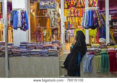Woman with black veil in Oman