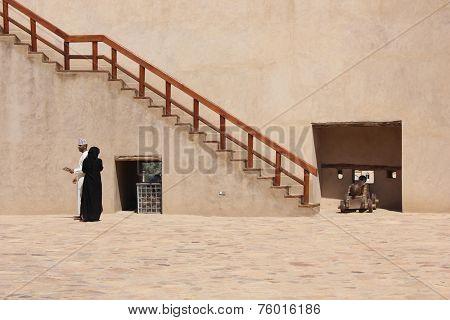 Islamic couple inside the Nizwa Fort Castle