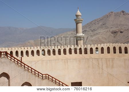Nizwa Fort Castle and mountains
