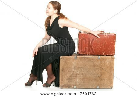 One Beautiful Woman In Black Dress Dragging Two Ancient Suitcases