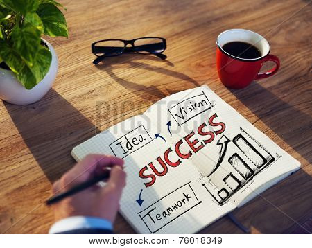 Man with a Note Pad and Success Concepts