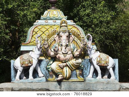 Lord Ganesha Flanked By Two Elephants