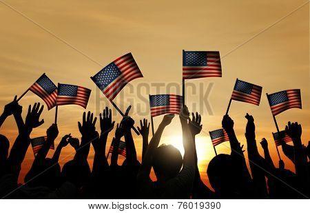 Group of People Waving Armenian Flags in Back Lit
