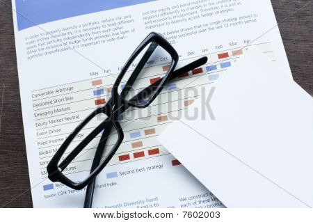 Economic plan and glasses