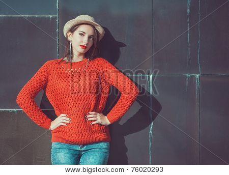 Young Beautiful Girl In Red Jersey And Hat