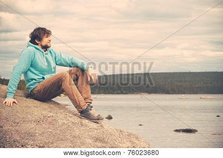 Young Man Traveler relaxing alone outdoor Lifestyle