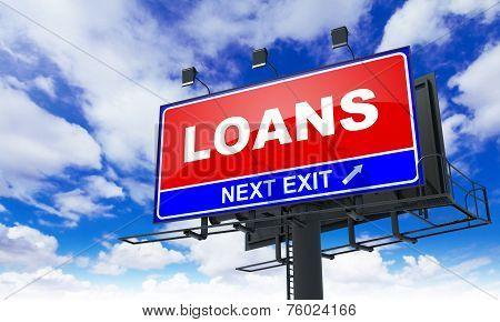 Loans Inscription on Red Billboard.