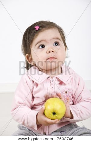 Thinking Toddler With An Apple
