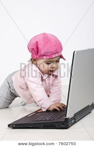 Happy Crawling Baby Type On Laptop