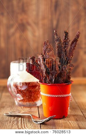 jerky beef in orange dish - homemade dried cured spiced meat