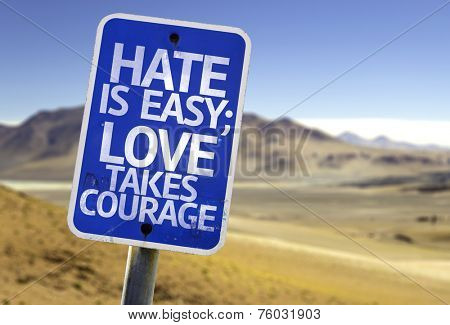 Hate is Easy Love Takes Courage sign with a desert background