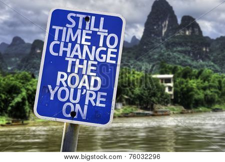 Still Time To Change the Road You're On sign with a forest background