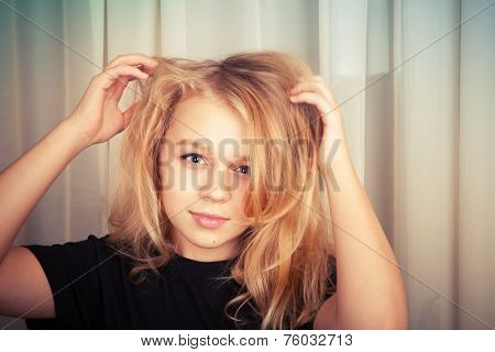 Blond Caucasian Girl With Disheveled Hair, Studio Portrait