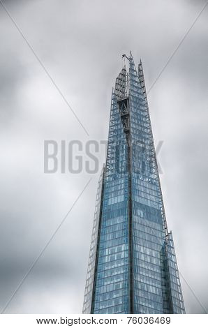 LONDON - 09 JUNE 2013: Famous Architectural The Shard of Glass Skyscraper Building in London that Forms Part of the London Bridge Quarter Development on 09 June 2013