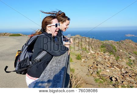Teenage Sisters Enjoying The Costa Brava Winds And Views