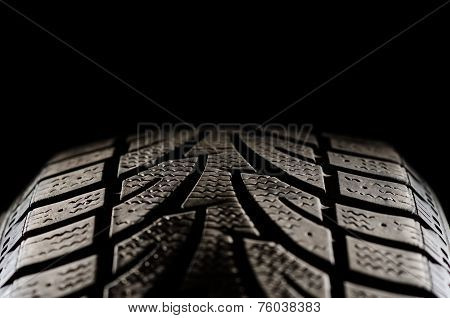 Tire on black
